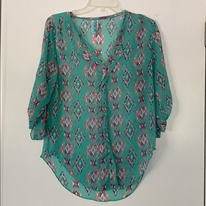 Sheer turquoise tribal print blouse